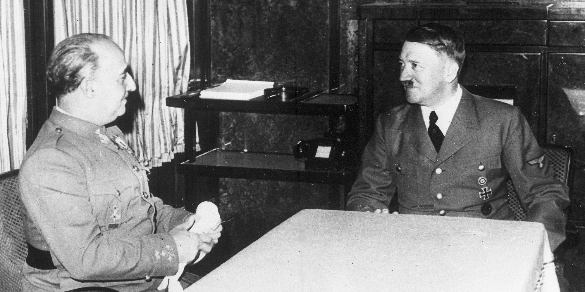 German Chancellor Adolf Hitler, right, talks with Spain's Generalissimo Franco, in Hendaye, France, Oct. 23, 1940, in Hitlers railway carriage during his trip to France, Spain and Italy. (AP Photo)