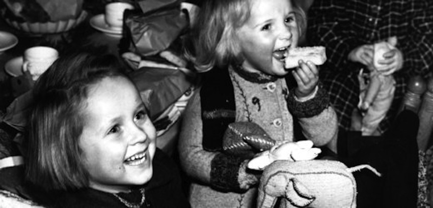 10th December 1945: Children whose parents perished in Nazi concentration camps have a Christmas party at Berlin. Various Berlin handicraft guilds made the children's presents - stuffed animals, motor cars, trains, and so on - and 100 orphans were chosen to receive them. (Photo by Fred Ramage/Keystone/Getty Images)