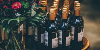 © Nick Karvounis, A group of red wine bottles next to a bouquet of roses, BY-SA CC 0.0